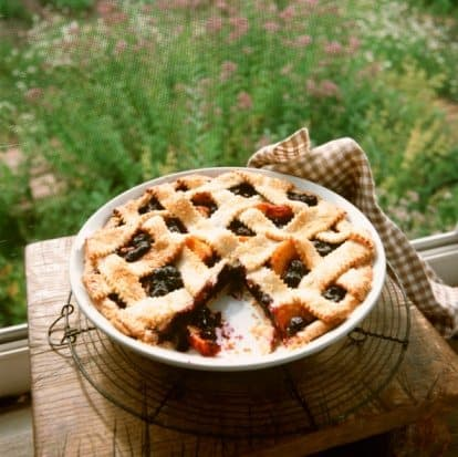 When the farmers market baskets are filled with summer's bounty of blueberries and peaches, this is a great recipe to combine both. My mom's Blueberry Peach Pie. | 31Daily.com