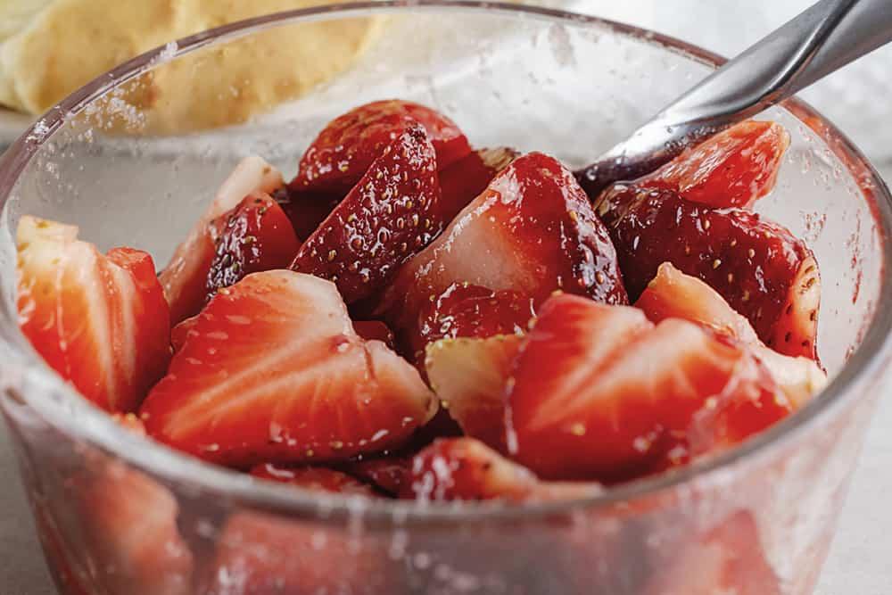Bowl of strawberries, cut up in sugar