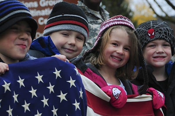Children hold a U.S. flag during the Veterans Day Parade at the Joint Multinational Readiness Center in Hohenfels, Germany, Nov. 8, 2012. The Veterans Day Parade and ceremony are annual events that are held to honor all those who have served in the United States military. (U.S. Army photo by Sgt. Mia Parker/Released)
