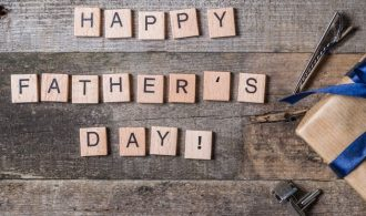 Happy Father's Day Letters on a Wood Background