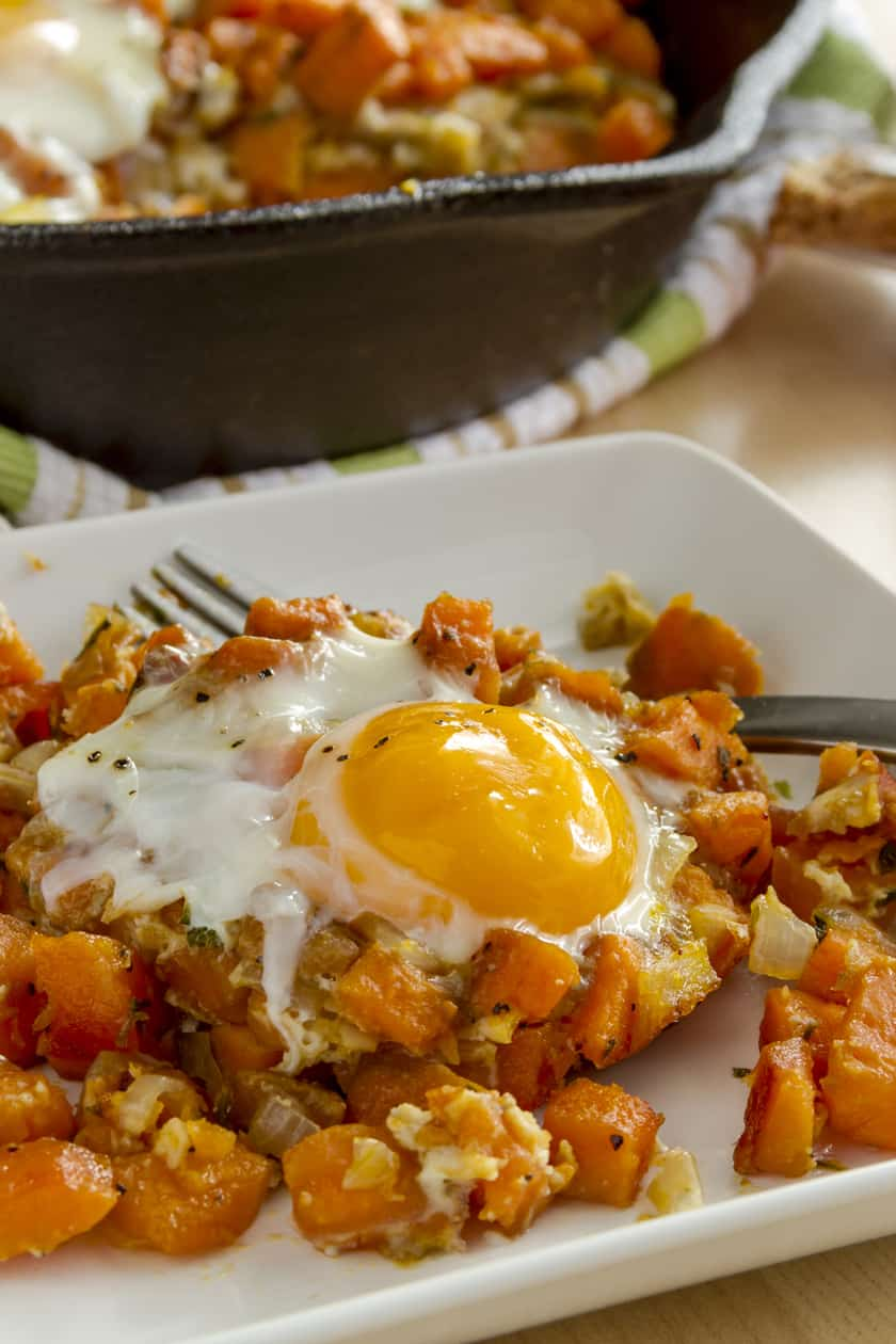 closeup of plated sweet potato hash with egg