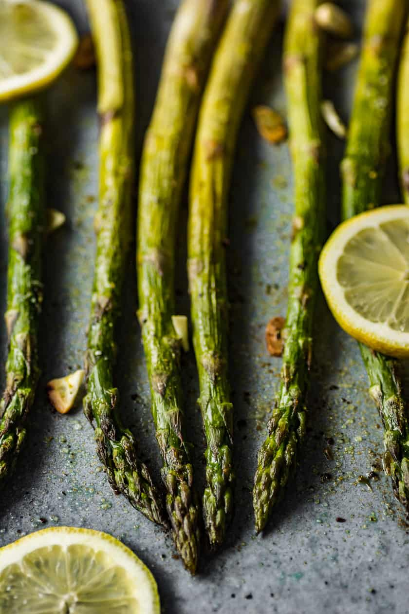 Roasted Asparagus on a Baking sheet with Slices of Lemon