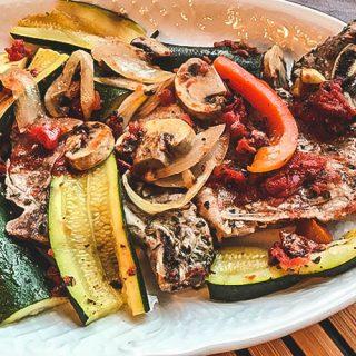 Italian Pork Chops on White Plate