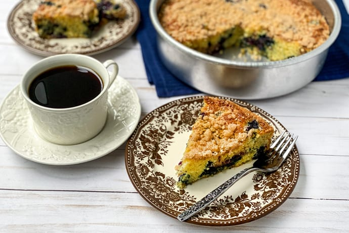 Slice of Blueberry Buckle Coffee Cake with Coffee
