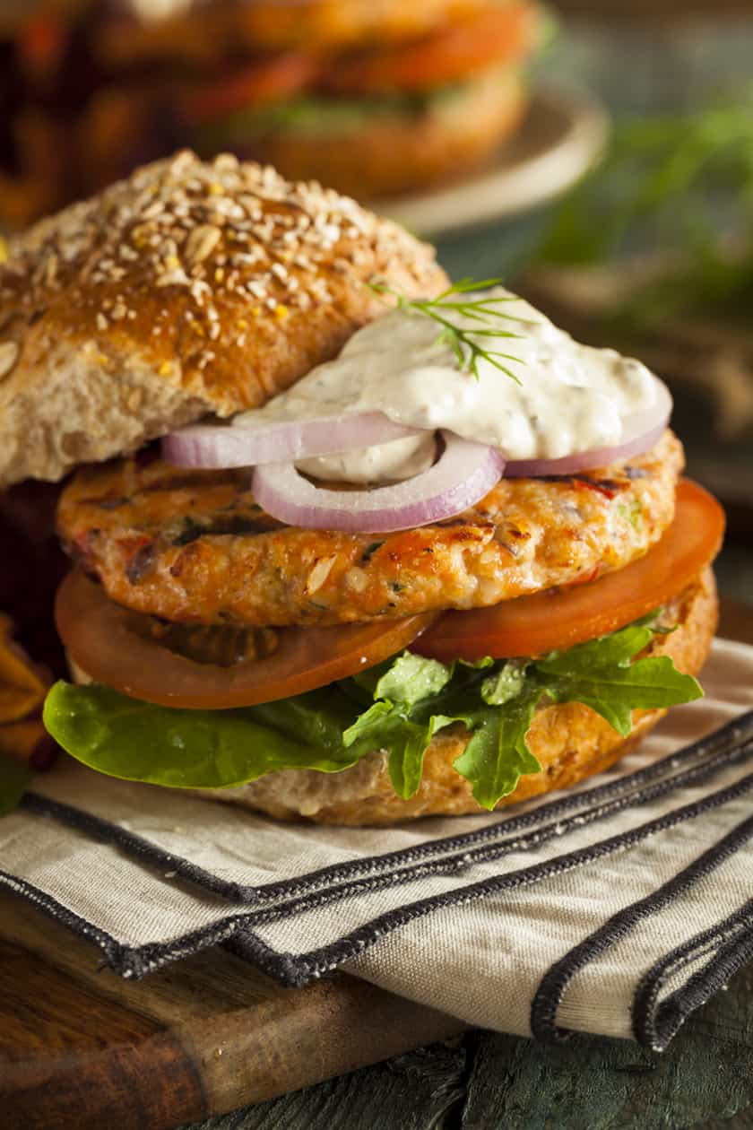 Salmon Burger topped with Red Onions and Tartar Sauce