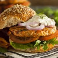 Salmon Burgers with tomatoes and lettuce on a bun
