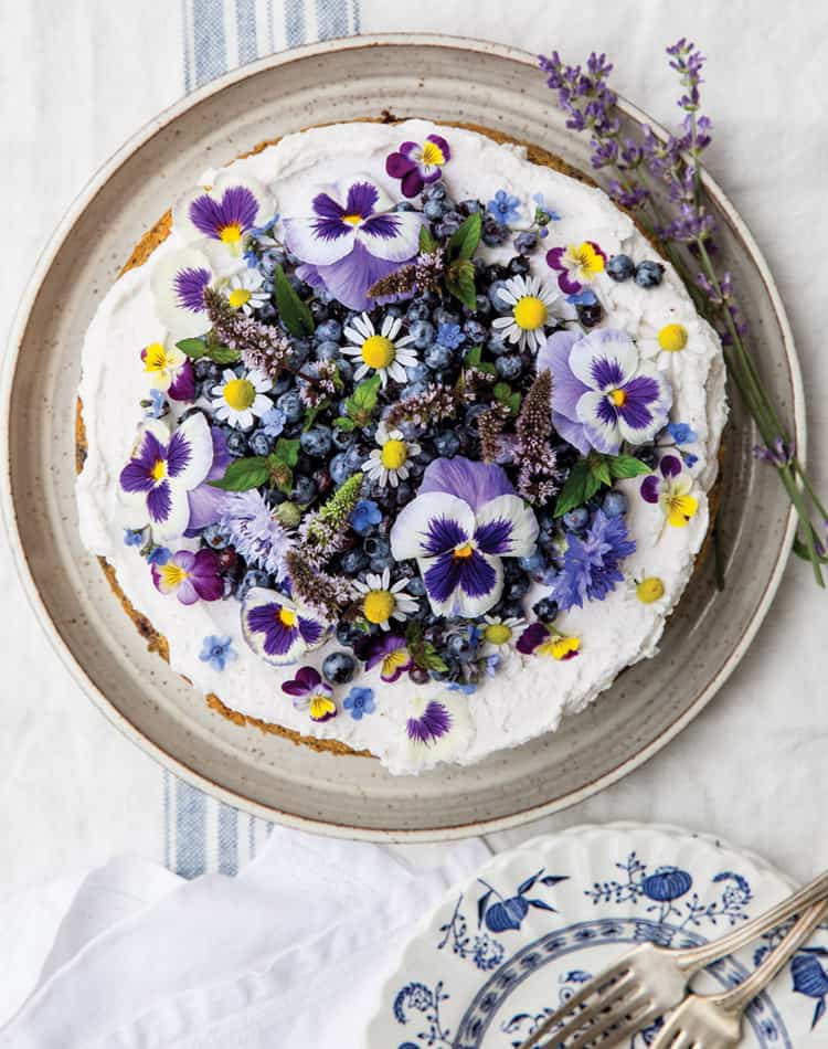 Wild Blueberry Lemon Poppy Seed Cake with Whipped Coconut Cream and Pansies