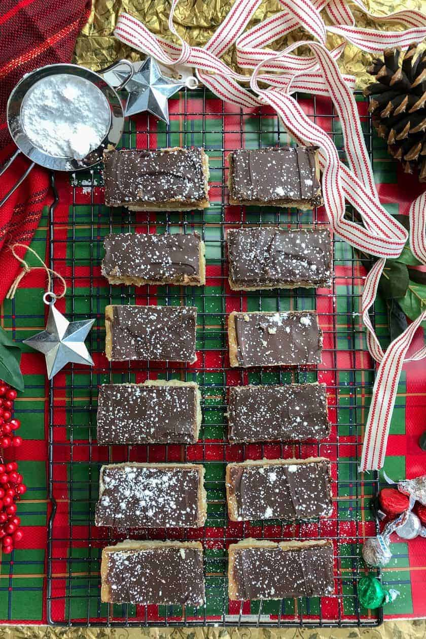 Top view of Scottish Millionaire Shortbread Cookies with Green and White Christmas Elements