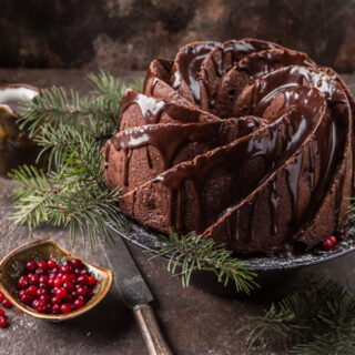 Top view of A Soft and Spicy Gingerbread Bundt Cake for the Holidays on a dark background