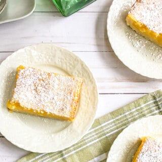 Top view of Lemon Bars on White Plates