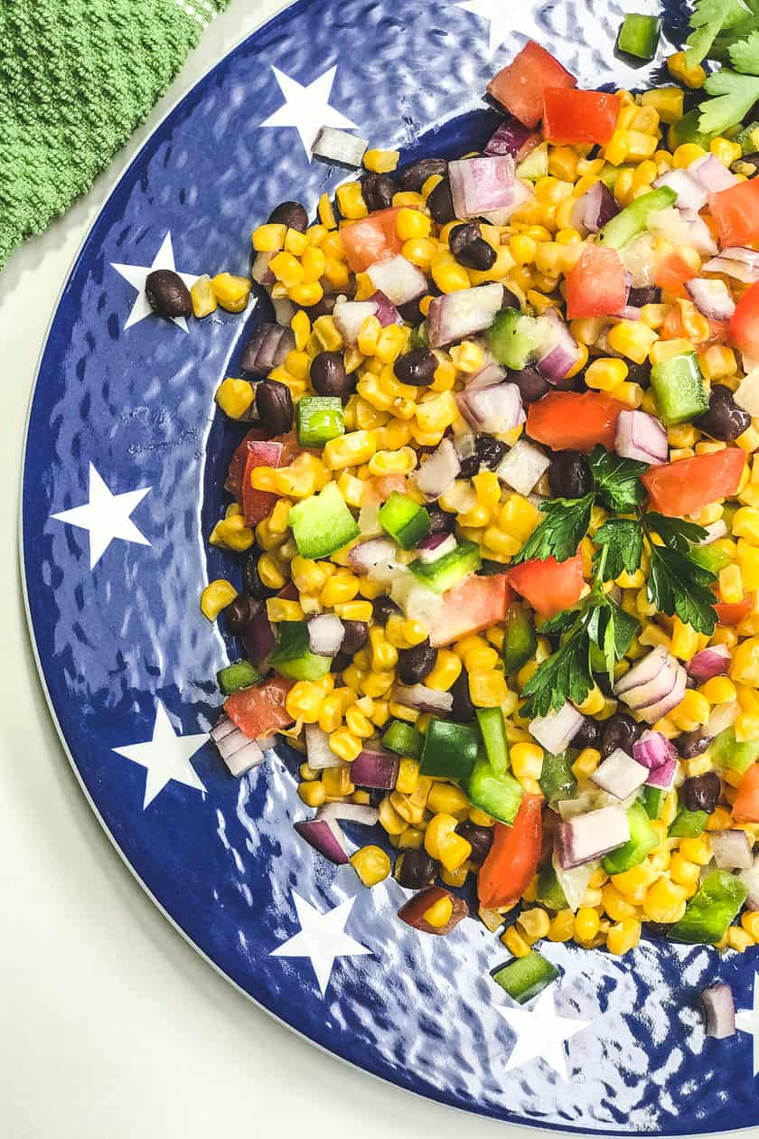 Closeup of Mexican Corn Salad on a blue star plate