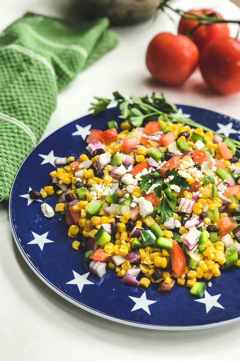 closup of Mexican Corn Salad on a blue plate