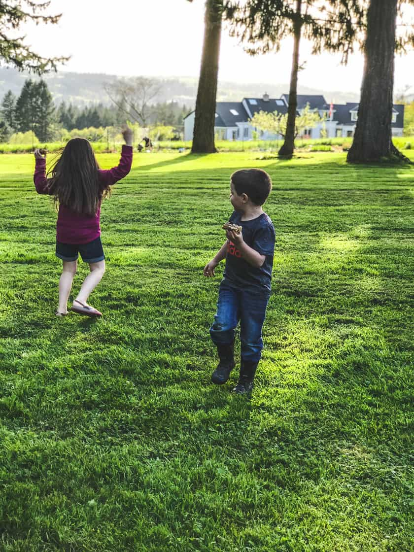 children playing outside with cookies