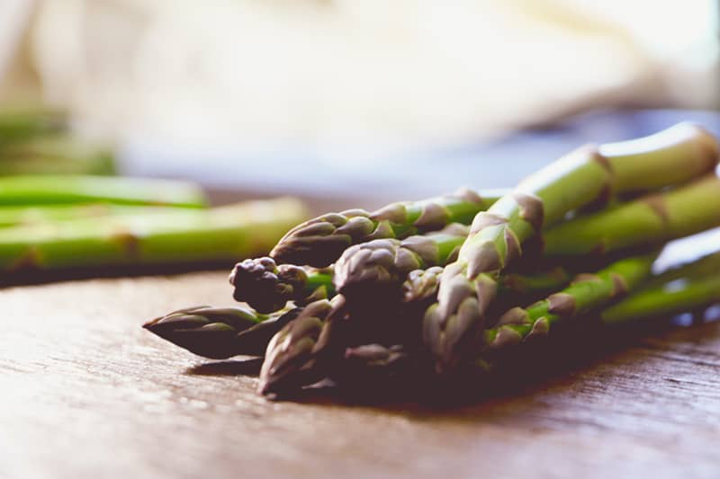 asparagus tips laying on a table