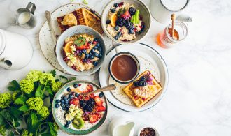 blueberries and strawberries on waffles and oats