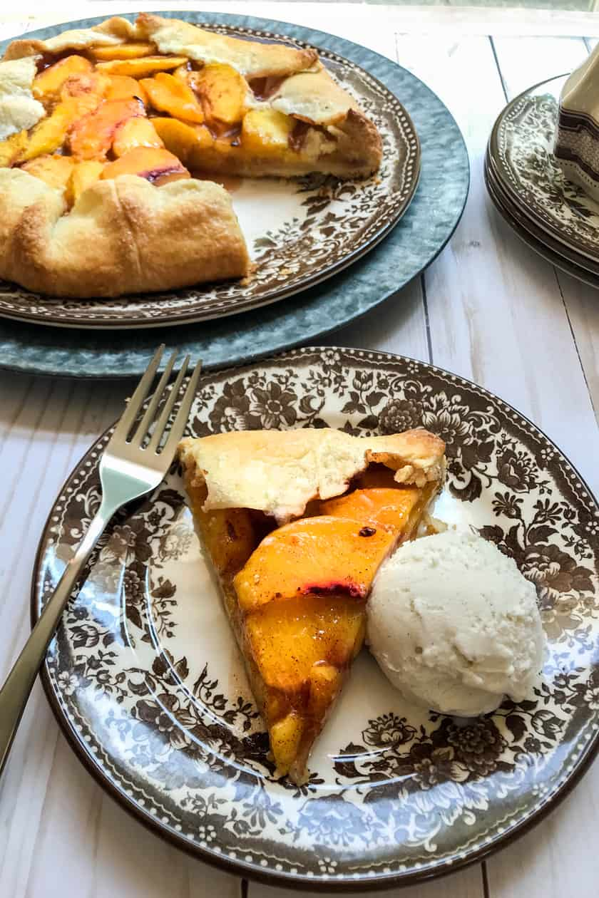 peach galette slice with ice cream
