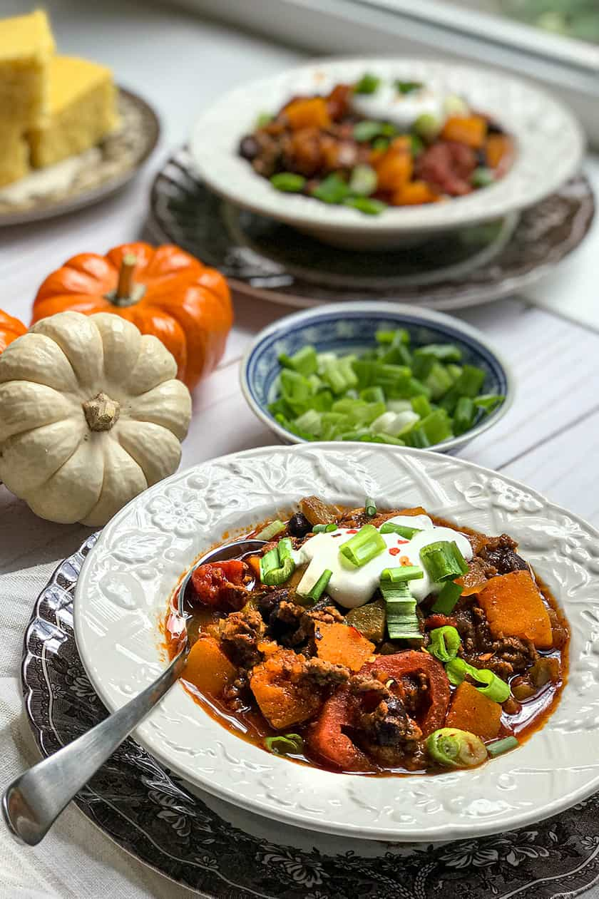 Bowl of Butternut Squash Chili with mini Pumpkins