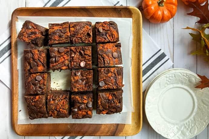 plate of mocha pumpkin brownies on wooden board