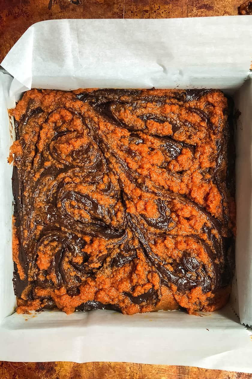 unbaked mocha pumpkin brownie batter in pan