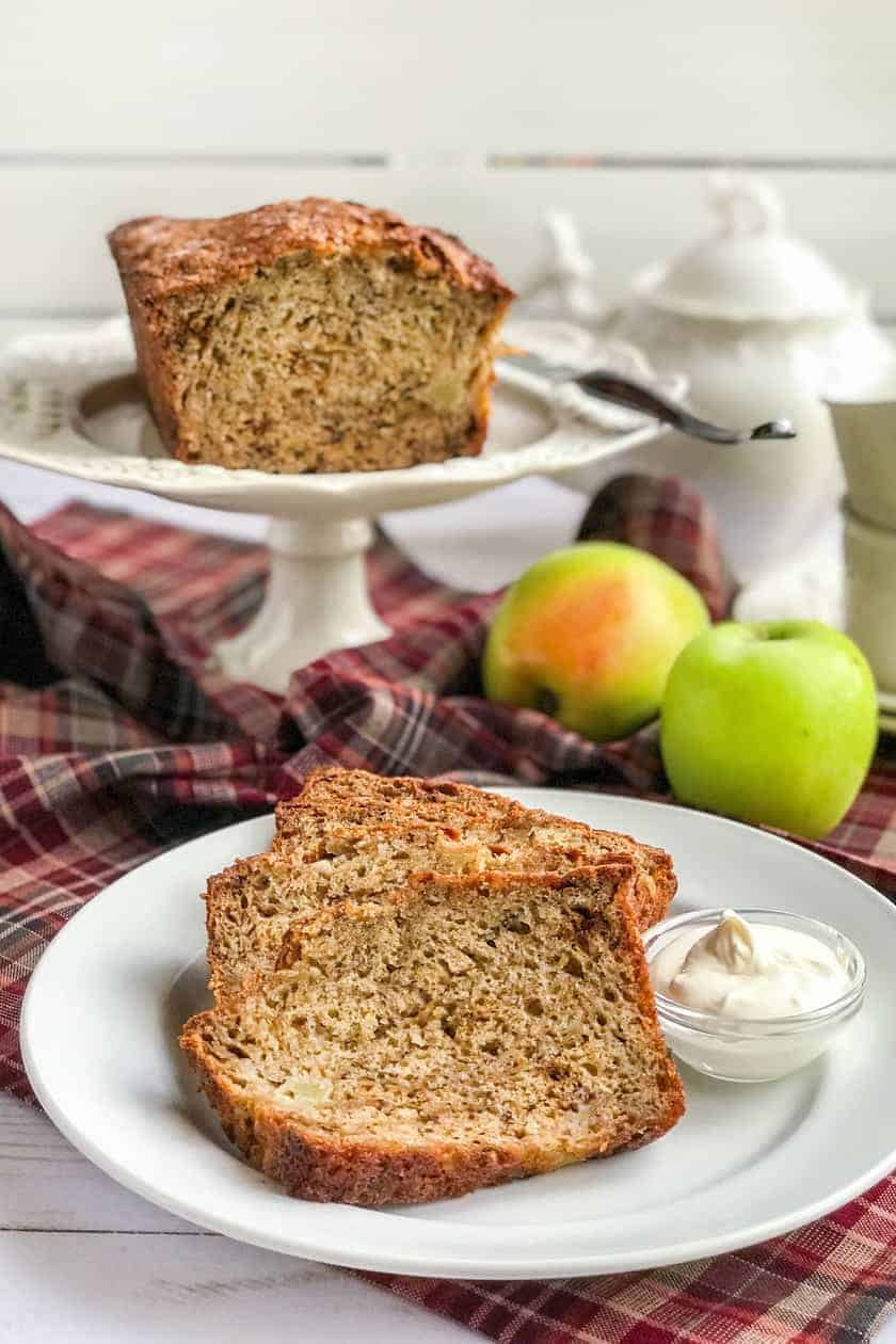 Maple Apple Banana Bread on a cake stand with sliced bread and teapot