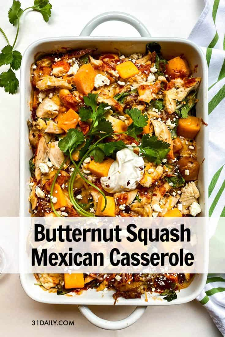 This easy, crowd pleasing Butternut Squash Mexican Enchilada Casserole is packed with flavor, vegetables, and bubbling with enchilada sauce and melty cheese. Easy Butternut Squash Mexican Casserole with Chicken and Kale | 31Daily.com #casserole #maindish #weeknightdinner #kale #chicken #blackbeans #enchiladas #Mexican #31Daily