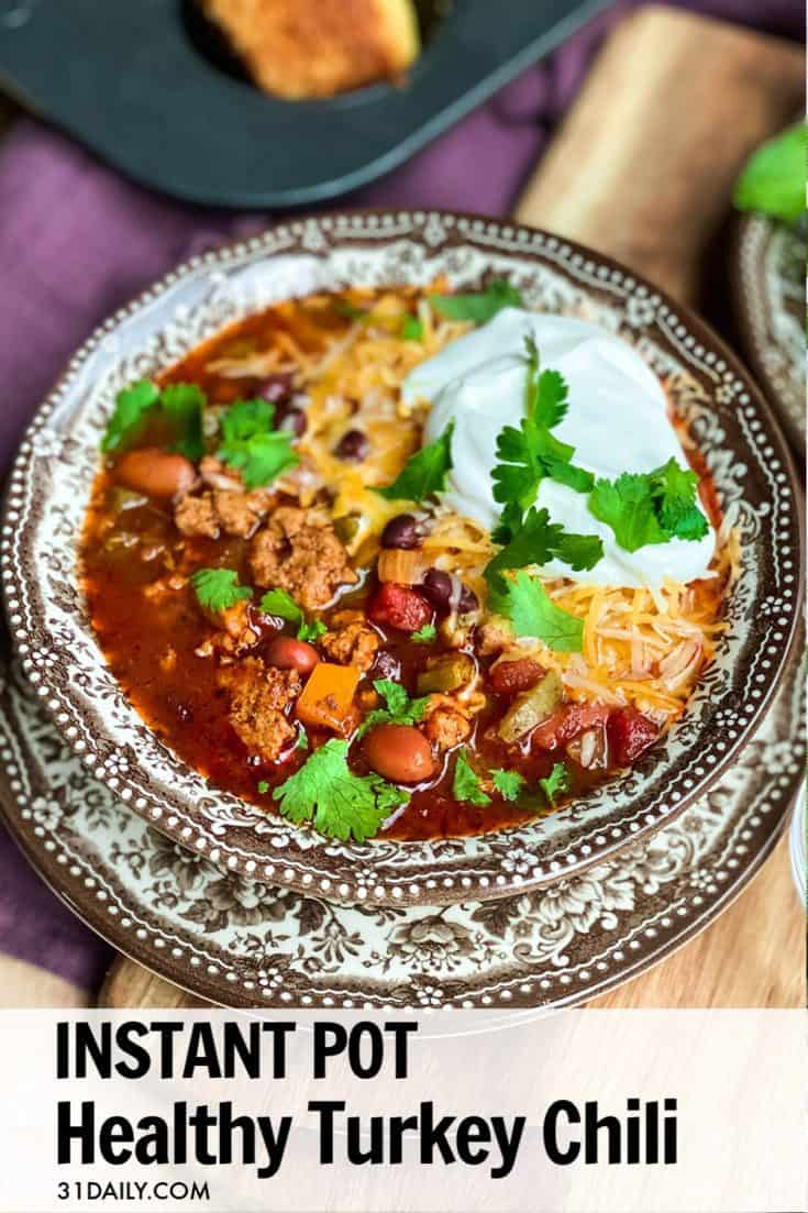 If you're looking for a healthy Instant Pot Turkey Chili recipe, this is one you have to try! We've fallen in love with the robust flavors, and easy enough to make on any day of the week. And, best of all, it's healthy! Perfect for weekends, game days or weeknight dinners. Healthy Instant Pot Turkey Chili | 31Daily.com #instantpotrecipes #instantpot #chili #turkeychili #healthyrecipes #pressurecooker #31Daily