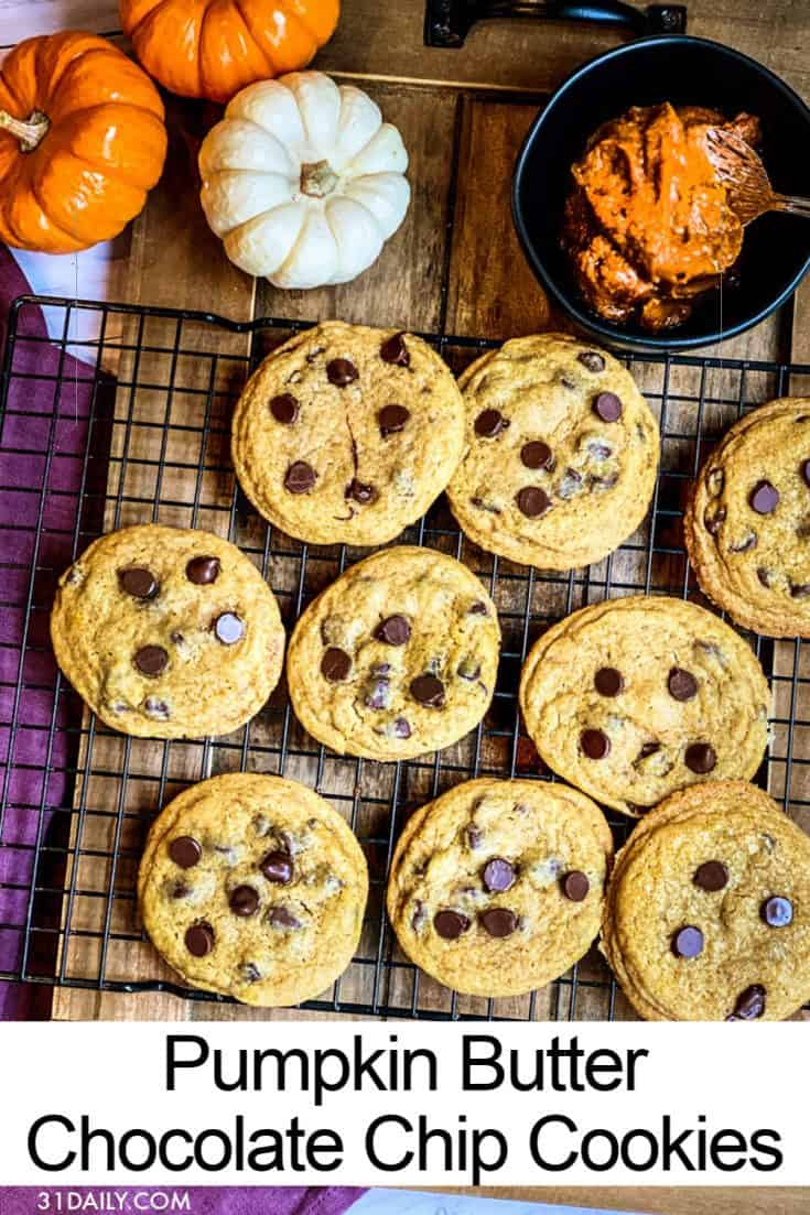 Pumpkin Butter Chocolate Chip Cookies combines the best of chocolate chip cookies and pumpkin spice. All in one crispy-edged, gooey, chocolaty cookie. Pumpkin Butter Chocolate Chip Cookies | 31Daily.com #pumpkinspice #halloween #thanksgiving #fall #cookies #chocolatechipcookies #pumpkinbutter #pumpkin #31Daily