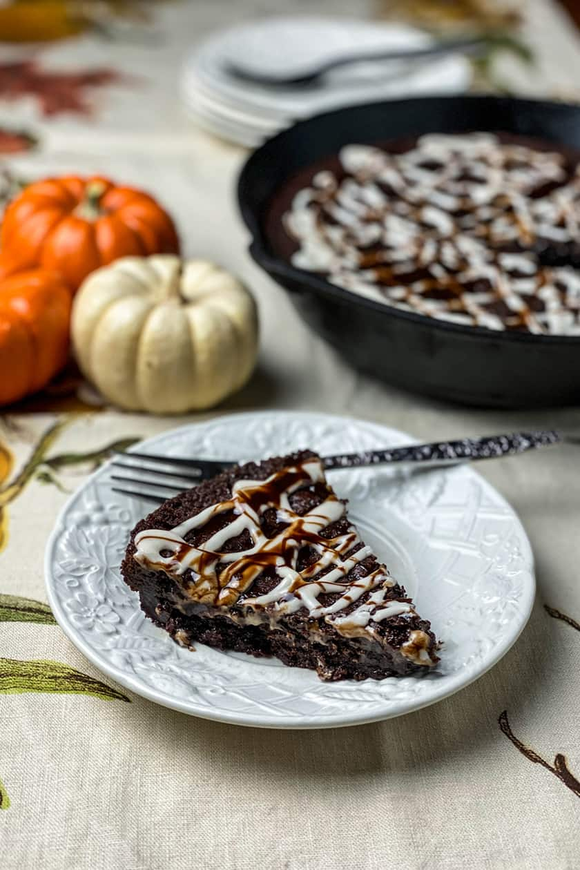 slice of a chocolate skillet brownie with maple glaze