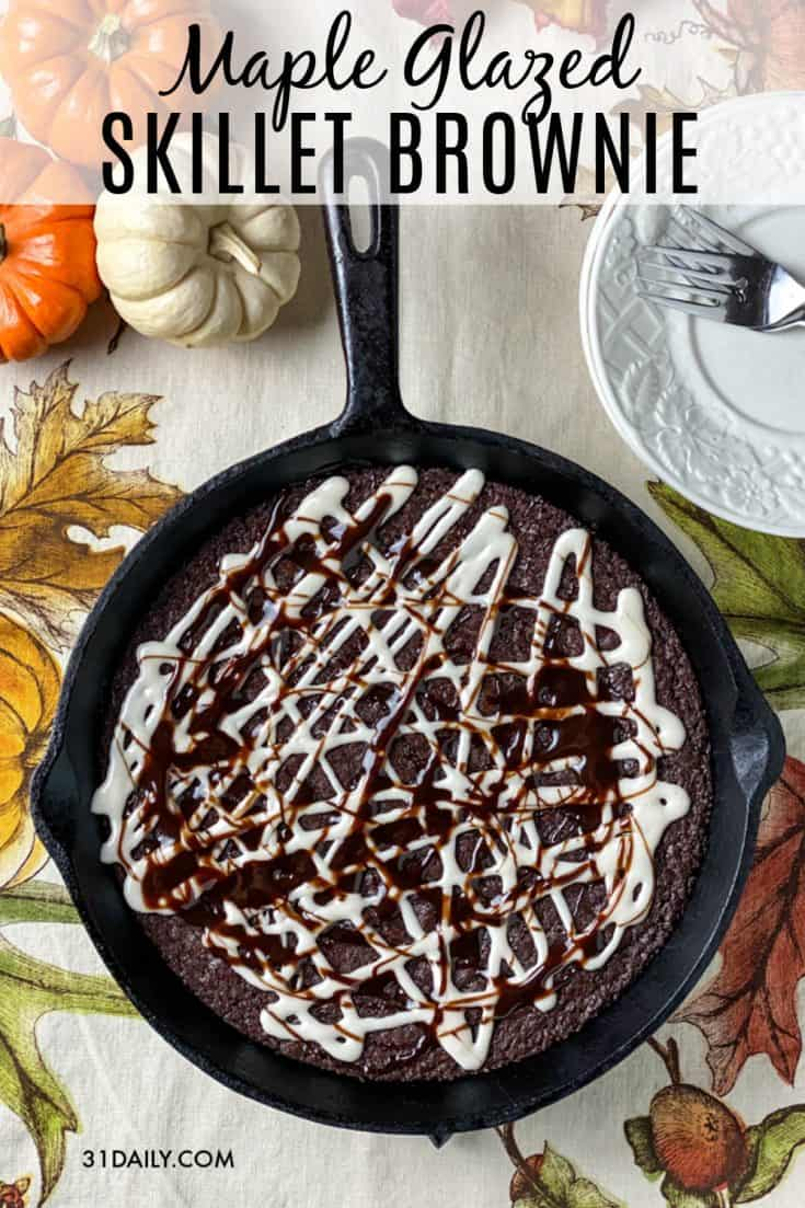 A decadently new favorite easy dessert, this Fudgy Skillet Brownie with Maple Glaze is having a huge moment in our kitchen. Densely chocolaty, fudgy and chewy, this brownie is a treat of all treats. Easy Fudgy Skillet Brownie with Maple Glaze | 31Daily.com #brownies #skilletcookie #skilletbrownie #desserts #chocolate #maple #fall #31Daily