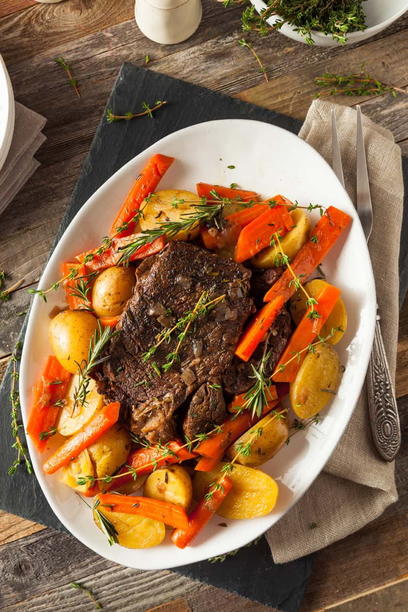 Whole Beef Pot Roast, Potatoes and Carrots on a Platter