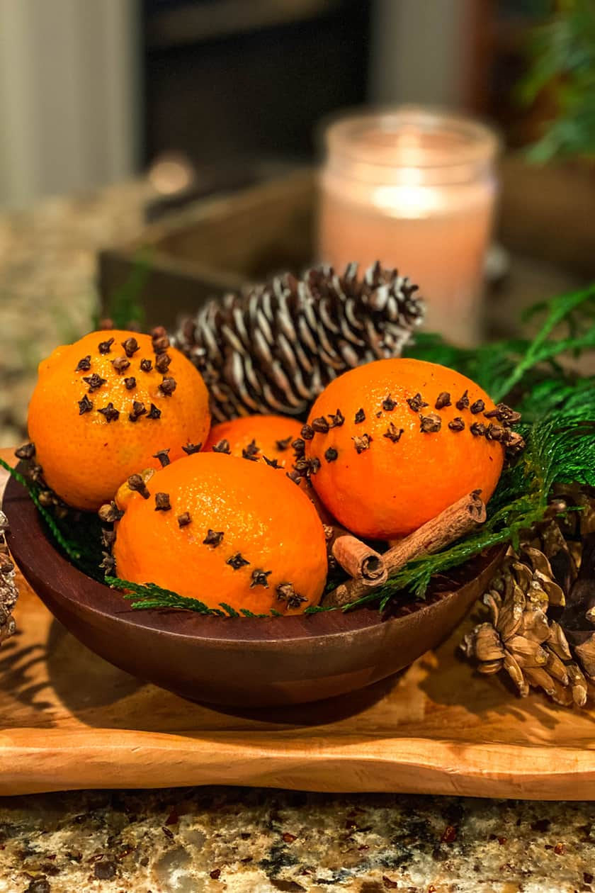 Orange Pomanders in a Wooden Bowl