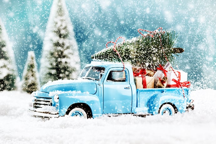 blue truck carrying Christmas gifts