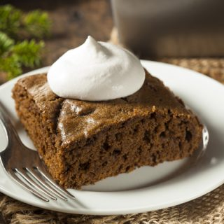 Square of Gingerbread Cake topped with Whipped Cream