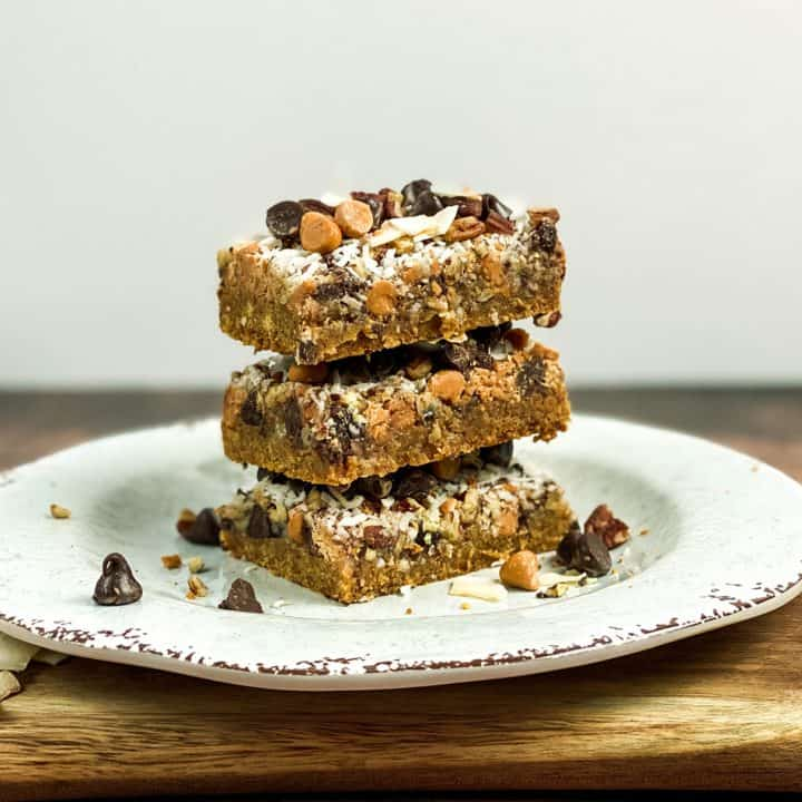 Stacked Magic Cookie Bars on White Plate