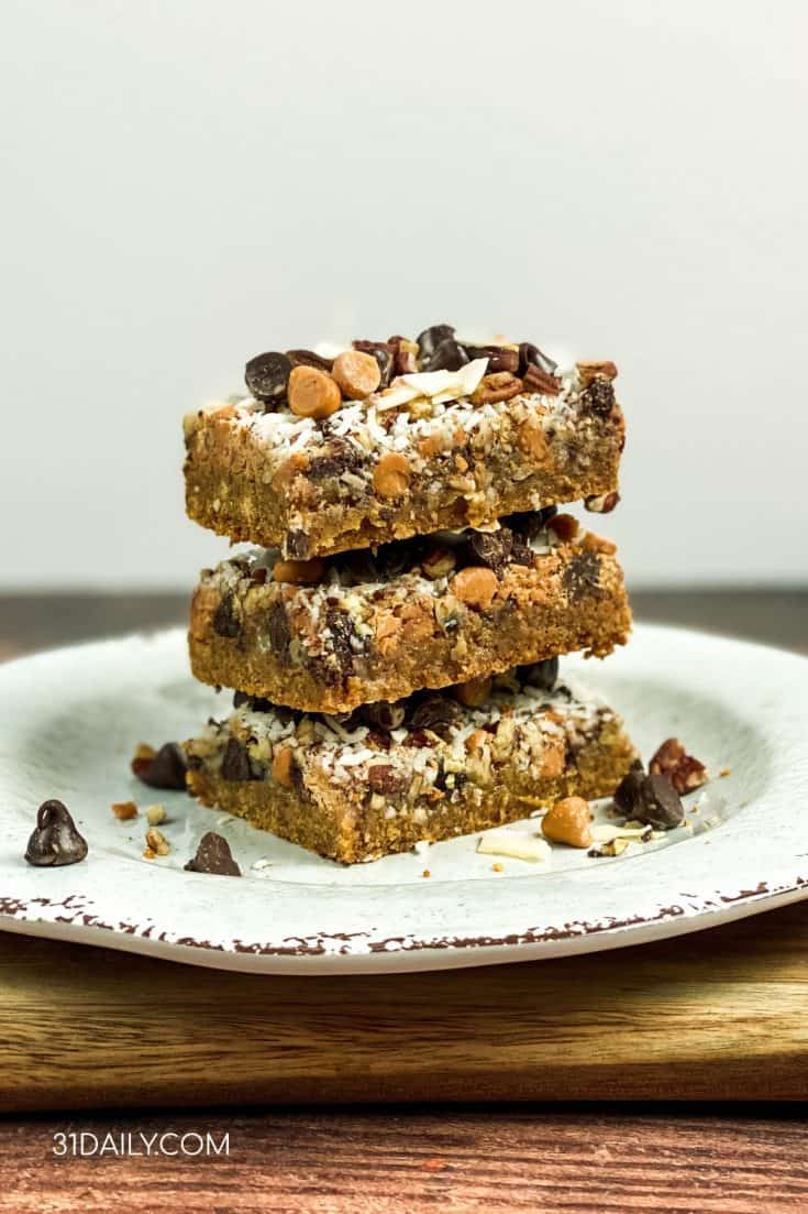 Butterscotch Chocolate Magic Cookie Bars are decadently delicious, addictively chocolaty and may seem a bit familiar. A dense and chewy cookie you'll love. Butterscotch Chocolate Magic Cookie Bars | 31Daily.com #cookies #barcookies #magicbars #gameday #holiday #butterscotch #chocolate #31Daily