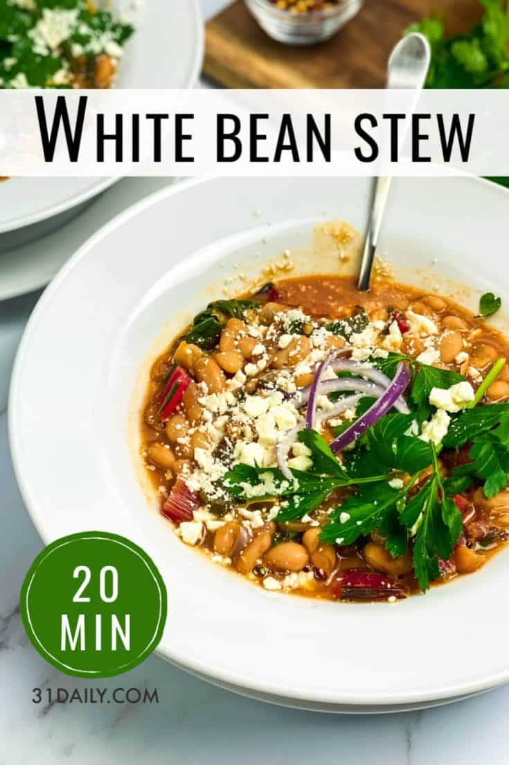 White Bean Stew with Swiss Chard is a hearty bowl of healthy, creamy comfort food, quickly made in about 20 minutes. Topped with feta and fresh parsley. White Bean Stew with Swiss Chard | 31Daily.com #beans #stew #soup #whitebeans #swisschard #healthy #quickandeasyrecipes #31Daily