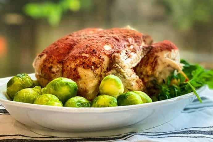 Closeup of Instant Pot Rotisserie Chicken on a White Platter