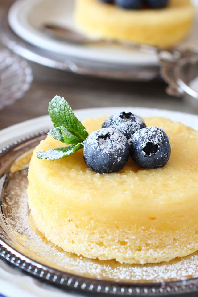 Closeup of Lemon Pudding Cake with Blueberries and Mint on a Silver Plate