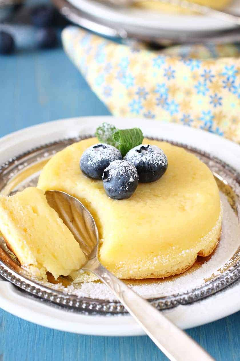 Closeup Lemon Pudding Cake with a Spoon and Blueberries