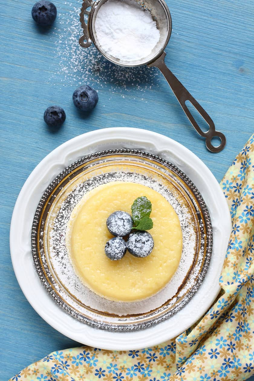Top view of Lemon Pudding Cake with Sugar Coated Blueberries