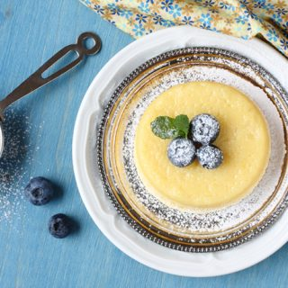 Lemon Pudding Cake with Blueberries and Dusted with Confectioners' Sugar