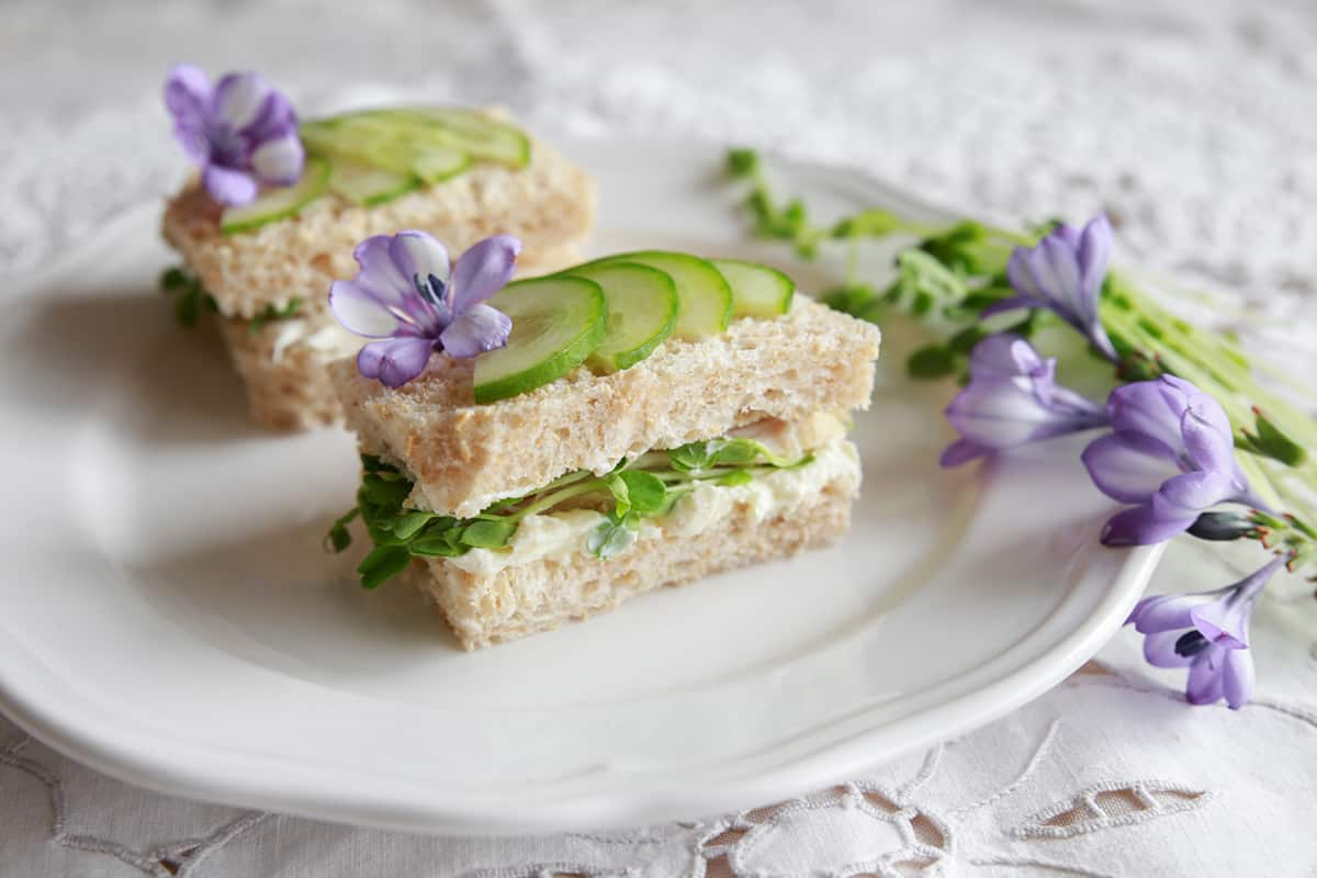 Cucumber Tea Sandwiches with Purple Freesia on a White Plate