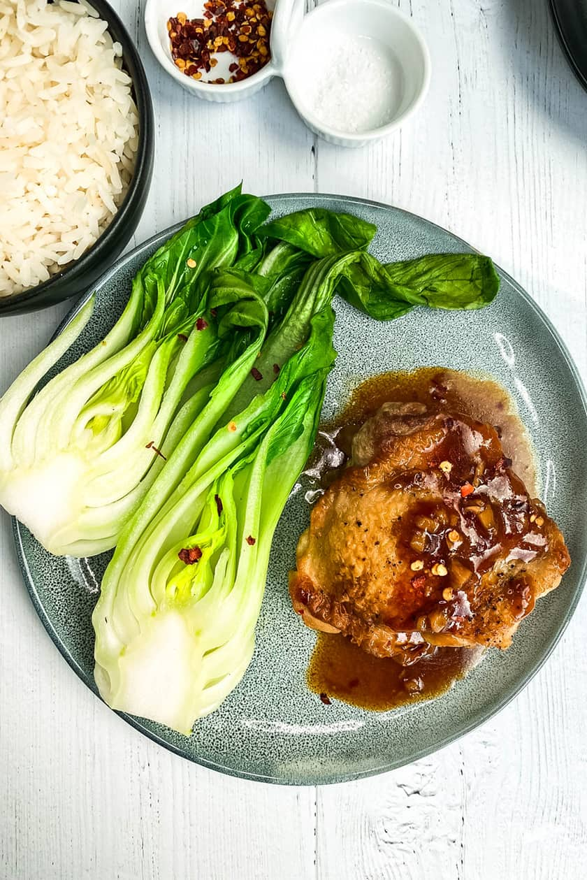 Instant Pot Kung Pao Chicken Thighs with Bok Choy on a Blue Plate