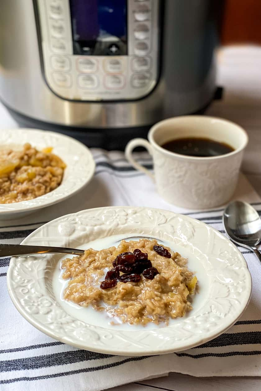 View of Instant Pot and Oatmeal with Raisins on top