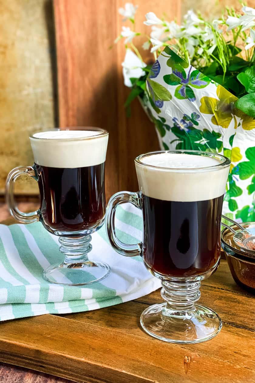 Two Mugs of Irish Coffee on a Green Cloth