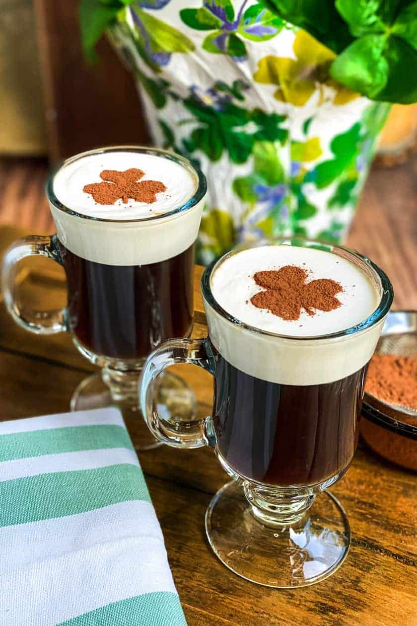 Mugs of Non Alcoholic Irish Coffee on a Wood Board with Shamrock Stencil