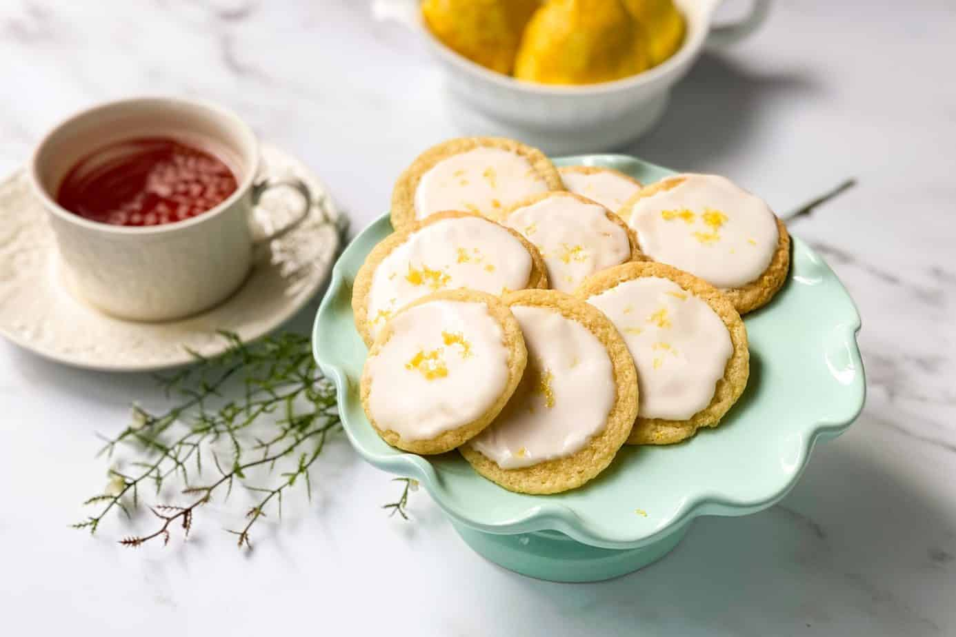 View of lemon tea cookies with sliced lemon and a cup of tea