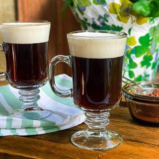 Two Mugs of Irish Coffee on a Wooden Board