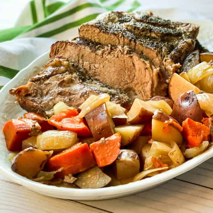 Sliced Pork Roast on a Platter with Potatoes