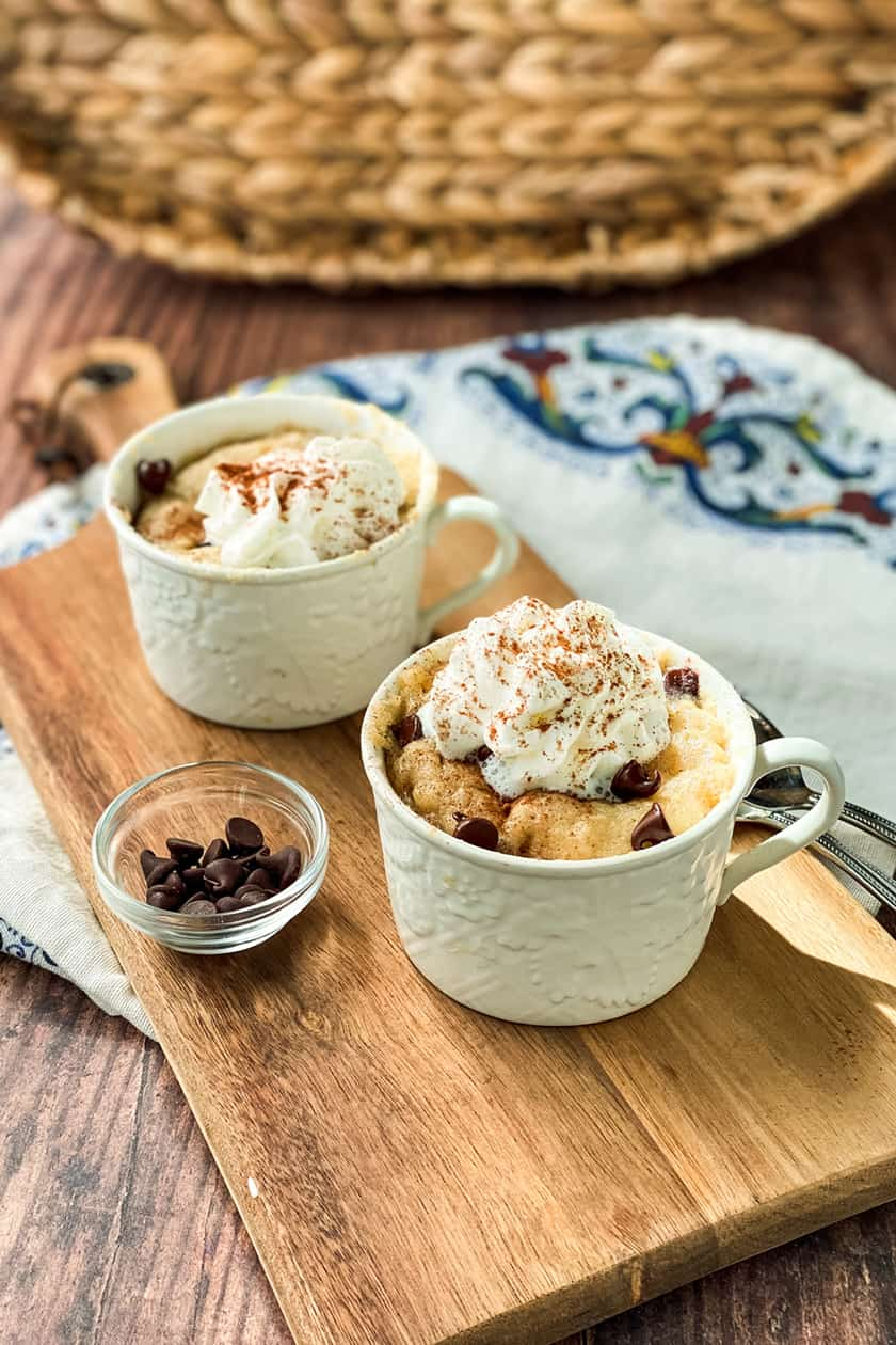 Mug Cakes topped with Whipping Cream and Chocolate Chips